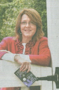 Writer Susan Crandall in her Yard